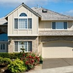 photo of beige colored 2 storied house with 2 car garage